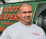 rooter employee in front of van